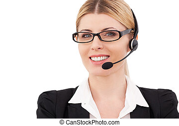 Always ready to help you. Confident mature customer service representative in headset looking at camera and smiling while standing isolated on white
