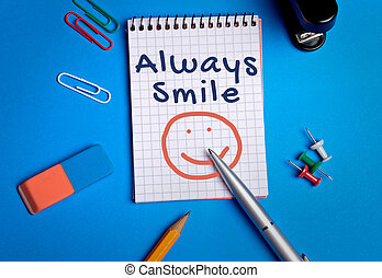 Always smile word on notebook