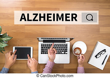 ALZHEIMER Two Businessman working at office desk and using a...