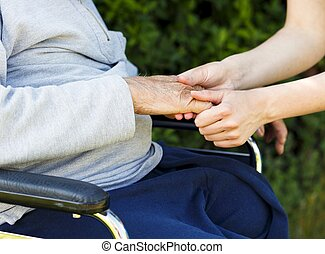 Giving support and care for elderly with Alzheimer's disease.