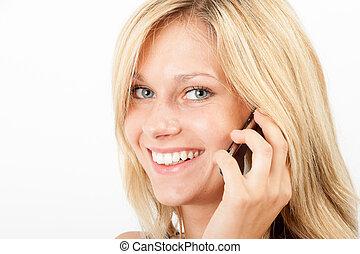 Am Telefon - Junge Frau telefoniert mit dem Handy