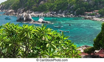 Amaing Tanote Bay with his beautiffull coral reef und huge granite blocks and longtail boat at anchor, Koh Tao, Thailand
