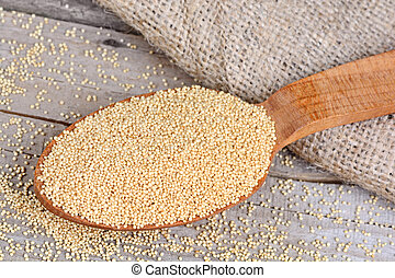 Amaranth seeds in a wooden spoon