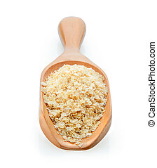 amaranth seeds on wooden scoop over white background