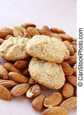 Amaretti macaroons on almond background