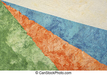 collection blue, orange, green, and white amate bark paper handmade created in Mexico from Amate, Nettle, and Mulberry trees