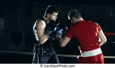 Amateur Boxing - Close up of two fighting in the ring in...