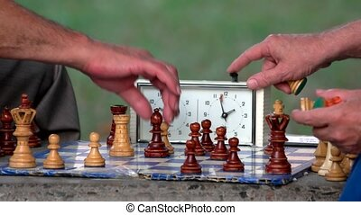 Amateur chess tournament. Retired people play chess, close...