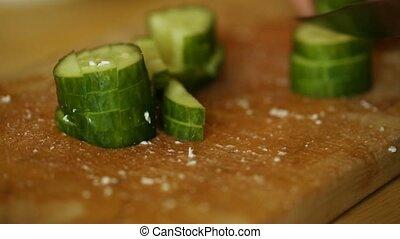 Amateur cooker cutting cucumber - Amateur female cooker...