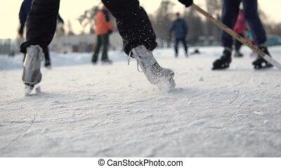 Day shot of amateur ice hockey play on frozen lake