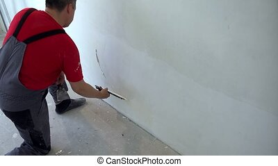 Amateur man do construction finishing works in his house. Do it yourself