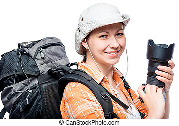 amateur photographer with a good camera and a large backpack on a white background