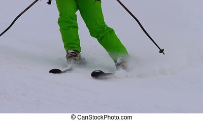 Amateur skier girl downhill, close-up view