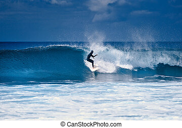 Amateur sport - Surfer riding on a large wave on the...