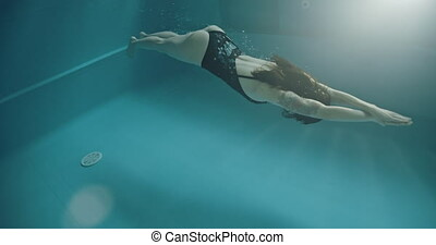 Amateur woman swimmer, dolphin style - Amateur woman swimmer...