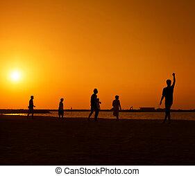 Amateurs playing football at Jumeira beach in Dubai
