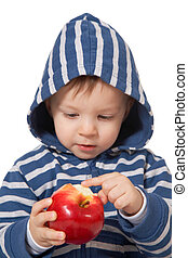 amazed baby with red apple