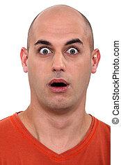 amazed bald man