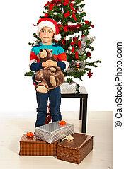 Amazed boy with Christmas gifts