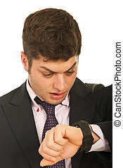 Amazed business man with watch