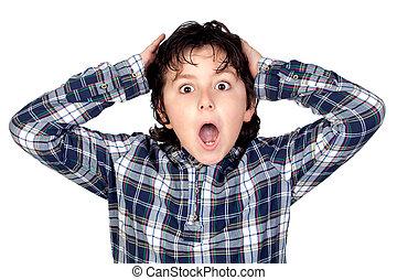 Amazed child with plaid t-shirt isolated on white background