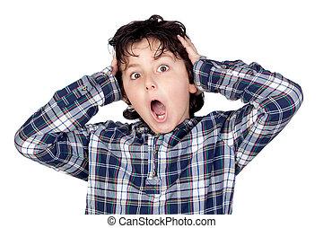 Amazed child with plaid t-shirt