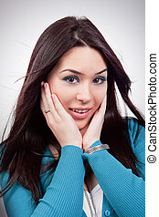 Amazed expression on young woman face