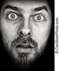 Amazed! - Face of very amazed man, on black background