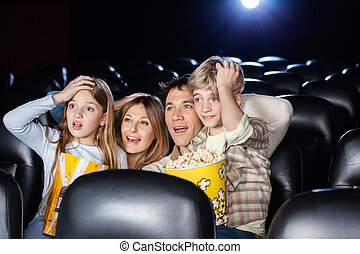 Amazed Family Watching Movie In Cinema Theater