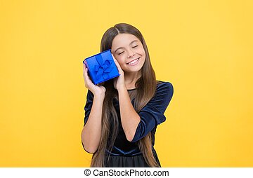amazed girl kid shopper with happy face holding gift box, christmas