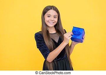 amazed girl kid shopper with happy face holding gift box, xmas