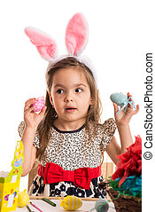 Amazed girl with Easter eggs
