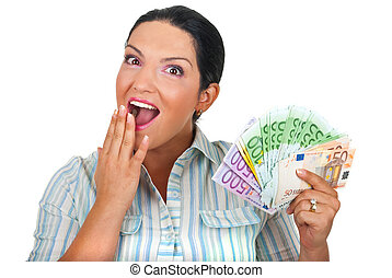 Amazed lady with handful of money - Surprised woman with ...