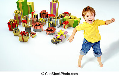 Amazed little boy with lots of presents