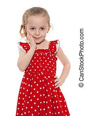 Amazed little girl in a red dress