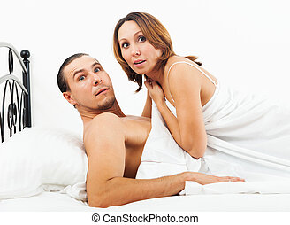 lovers caught in bed