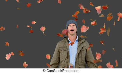 Amazed man looking at falling leaves on grey screen in slow...