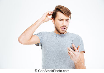 Amazed man looking on smartphone isolated on a white...