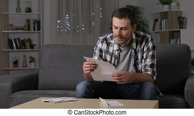 Amazed man reading good news on letter - Amazed man reading...