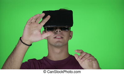 Amazed millennial male with VR virtual reality goggles...