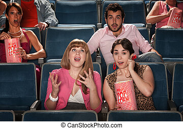 Amazed People In Theater - Group of amazed people watch ...