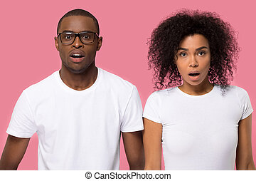 Amazed surprised young African American couple with open mouth