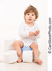 Amazed toddler boy on potty