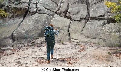 Amazed Woman among Rocks - Amazed, good-looking woman...