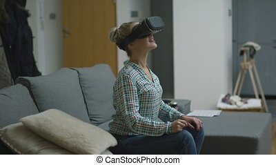 Amazed woman in VR headset - Beautiful young woman in...