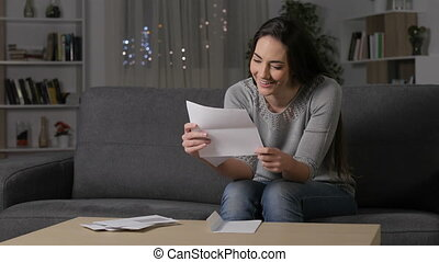 Amazed woman reading good news on letter - Amazed woman...