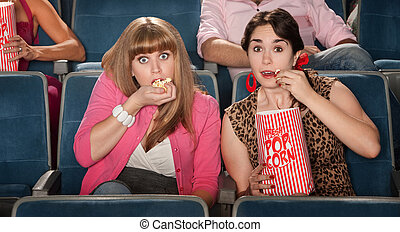 Amazed Women Eating Popcorn