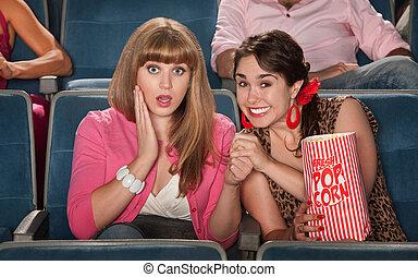 Amazed Women In Theater