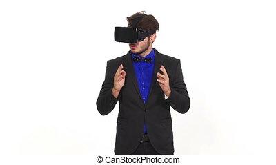 Amazed young man wearing virtual reality glasses