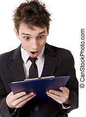 Amazement - Image of shocked businessman looking at document...